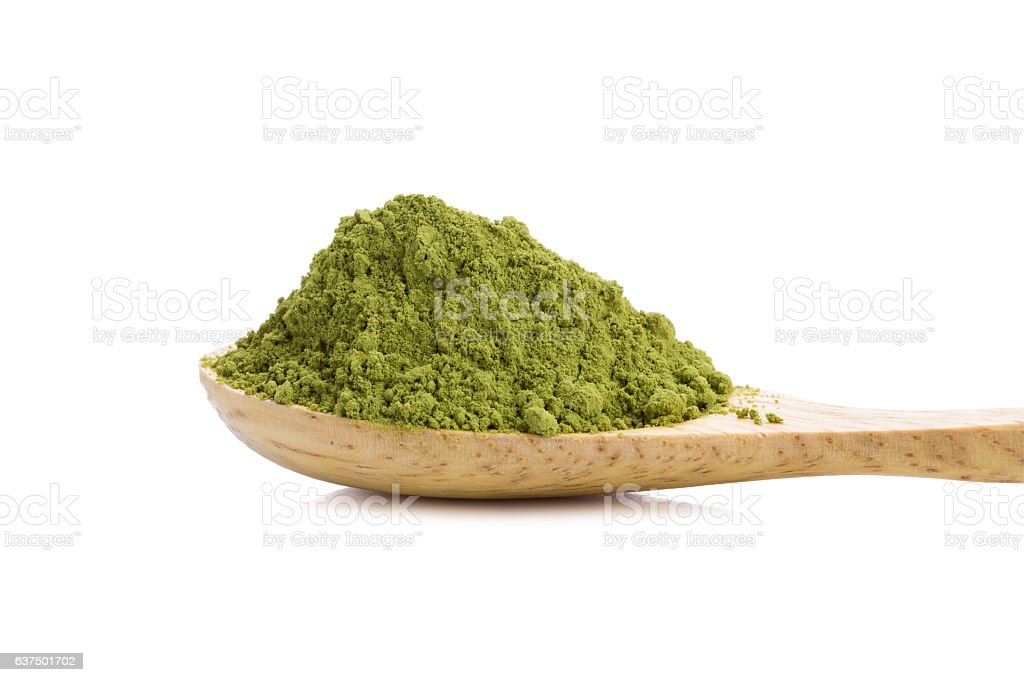 powdered green tea with bamboo spoon  on white background. stock photo
