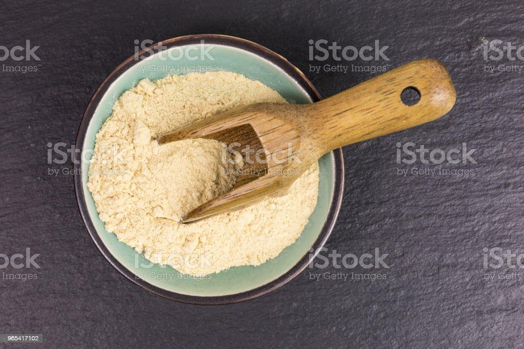 powdered maca root royalty-free stock photo