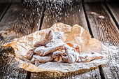 Powdered sugar falling on angel wings