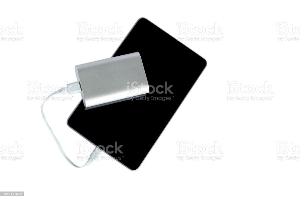 Power bank charging the tablet isolated on a white background royalty-free stock photo