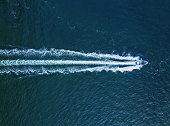 Aerial view of a powerboat in open ocean.