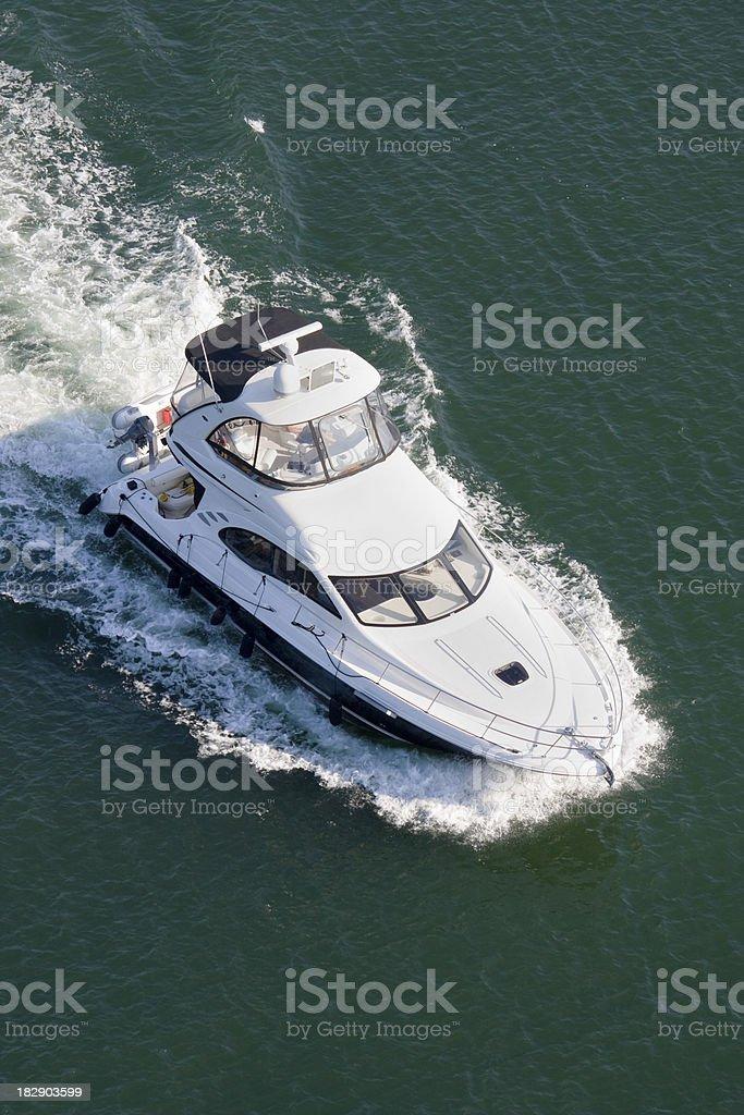 Power boat cruising into the marina. stock photo