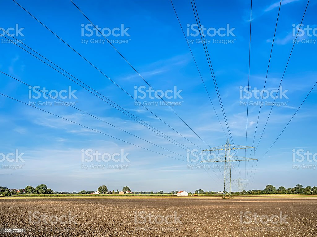 Power calbe over a field stock photo
