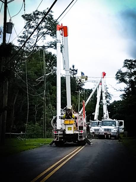 Power company trucks and crew repairing damage from summer thunderstorm Sawmill Road, Mercer County, New Jersey knocked down stock pictures, royalty-free photos & images