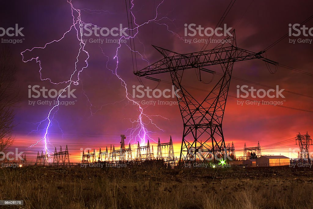 Power Distribution Station with Lightning Strike. stock photo