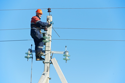 Power Electrician Lineman At Work On Pole Stock Photo - Download Image Now