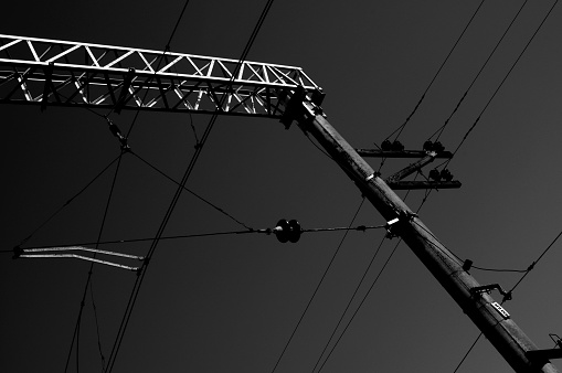 Power electricity wire for trains against sky. Close up of railway electrification system