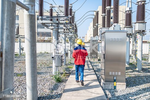 Power engineer checking electrical equipment at substation