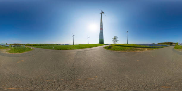 power generating wind turbines and the solar panels in the countryside (360-degree panorama) 360 degrees spherical panoramic shot of wind turbines and modern solar panels in a rural landscape high dynamic range imaging stock pictures, royalty-free photos & images