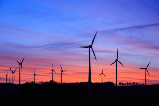 wind turbines in the country side in the evening