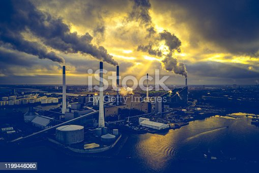 Aerial shot of energy plant driven by sustainable biomass in Copenhagen, Denmark. This fossil free energy system is fueled biomass, a renewable energy source. Aerial view shot with drone as HDR (high dynamic range).