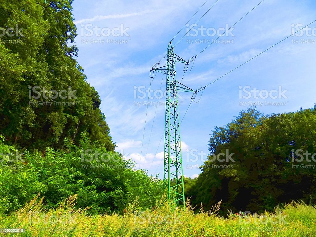 Power line column on meadow royalty-free stock photo