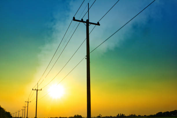 Power line pole Sunset power line pole in countryside electricity pylon stock pictures, royalty-free photos & images