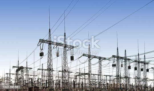power line pylons and transformers in the daytime. distribution, transmission and consumption of electricity.