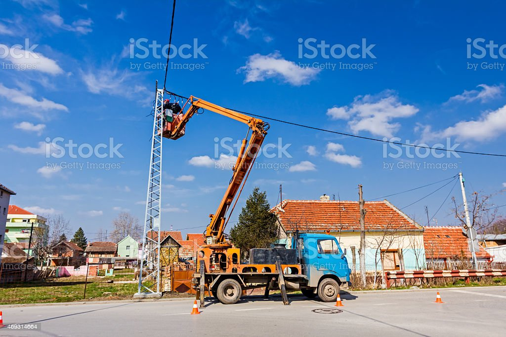 Power line team at work on a pole stock photo