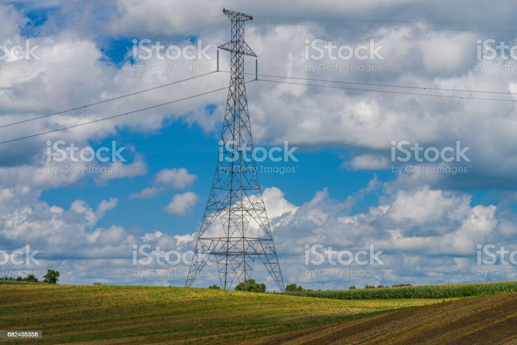 power line tower above farmland royalty-free stock photo