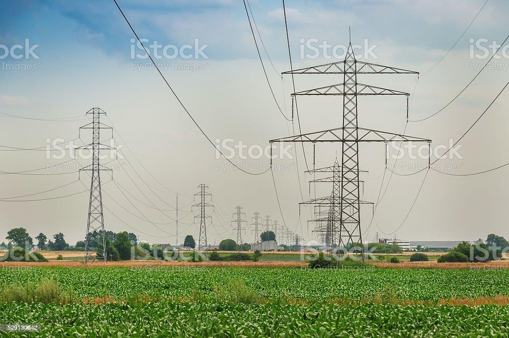 power line under cloudy sky stock photo