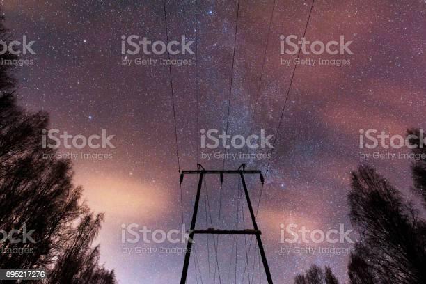 Photo of Power line under starry sky