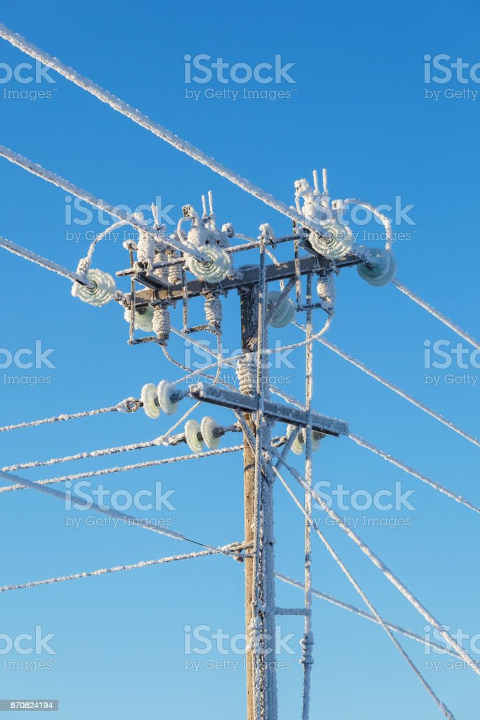 Power line with frost on a cold winter day stock photo