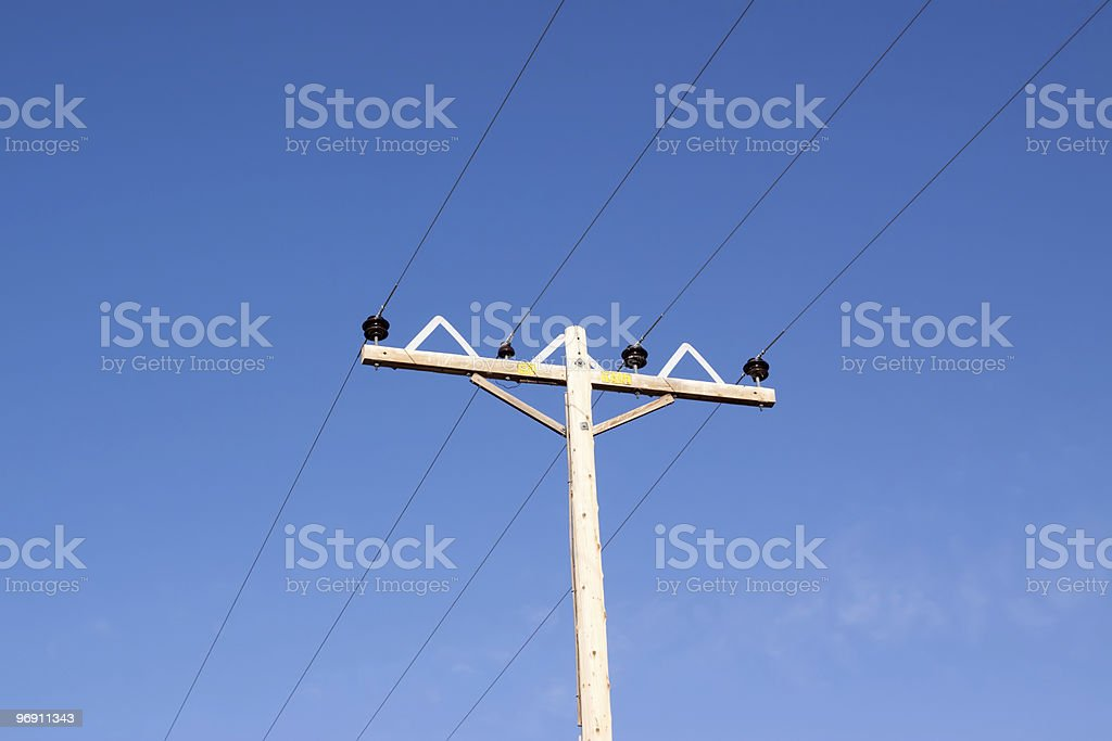Power lines against blue sky royalty-free stock photo