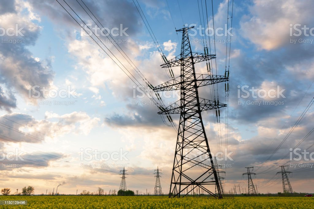 Power lines and high-voltage lines against the backdrop of blooming...