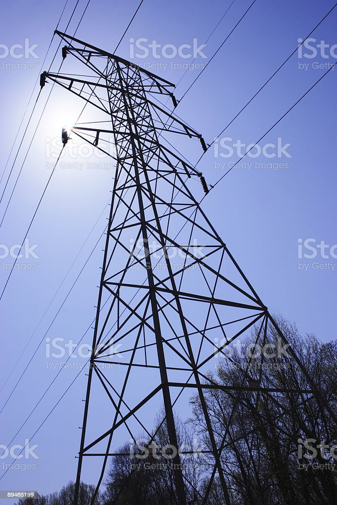 Power Lines and Pylon Silhouette royalty-free stock photo