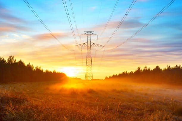 Power lines and sunrise landscape Power lines and scenic sunrise landscape with morning fog at meadow by the forest, Spain electricity pylon stock pictures, royalty-free photos & images