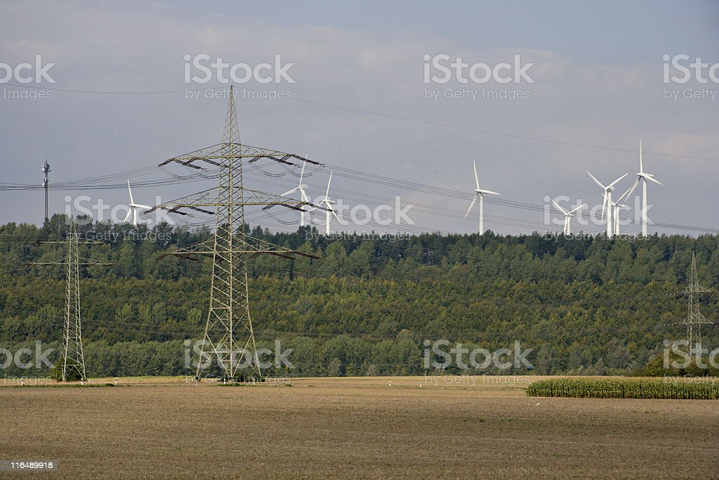 Power Lines And Wind Turbines royalty-free stock photo