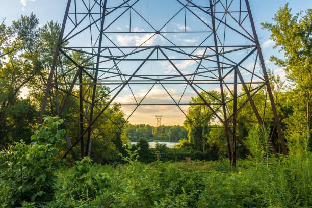 Power lines at sunrise stock photo