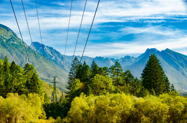 Power lines high in the mountains. Soca valley, Slovenia. Energy transmission in mountain regions