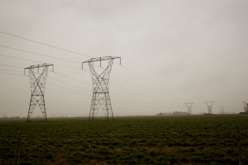 Power Lines In A Field Stock Photo - Download Image Now