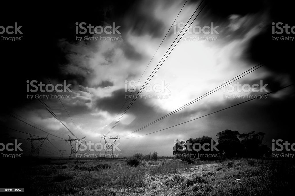 Power lines in field royalty-free stock photo