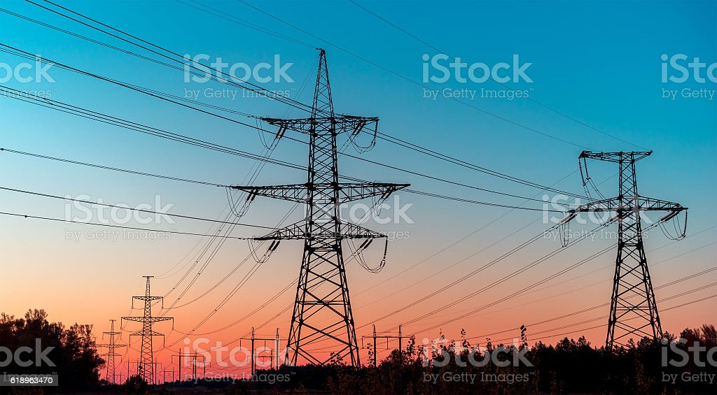 Power lines on a colorful sunrise ,Electric power lines against stock photo