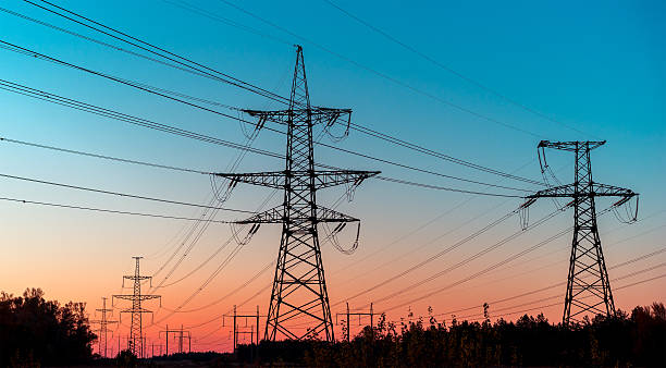 Power lines on a colorful sunrise ,Electric power lines against