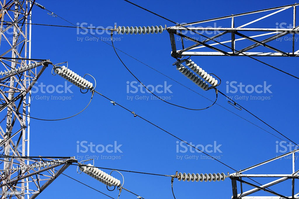 Power lines on blue sky royalty-free stock photo