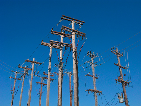 Power lines on wooden poles