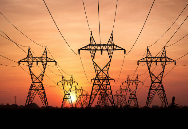 Power lines Electricity Pylons at sunset on background electricity pylon stock pictures, royalty-free photos & images