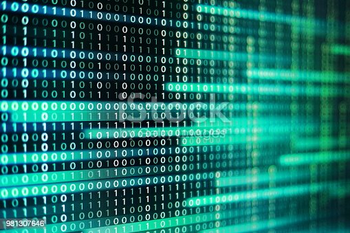 istock power of big data. binary code information bit on computer monitor screen display. Led light text number one and zero. blur defocus blue bokeh light. technology graphic design background concepts 981307646