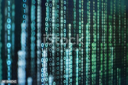 istock power of big data. binary code information bit on computer monitor screen display. green light text number one and zero. blur defocus blue bokeh light. technology graphic design background concepts 981849242