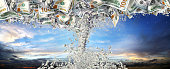 Conceptual business and finance image of money storm over dramatic sky
