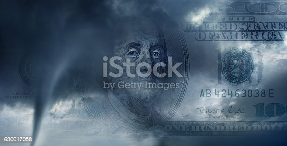 conceptual image of one hundred dollar bill in tornado