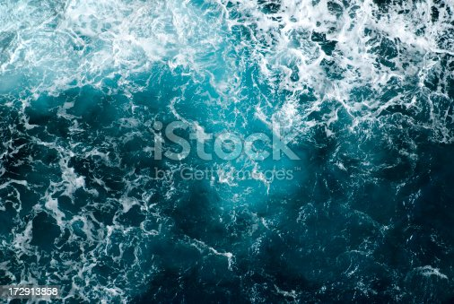 Deep turquoise water of the Mediterranean Sea shows it's power when waves crash on the cliffs of Capo Caccia, Sardinia.