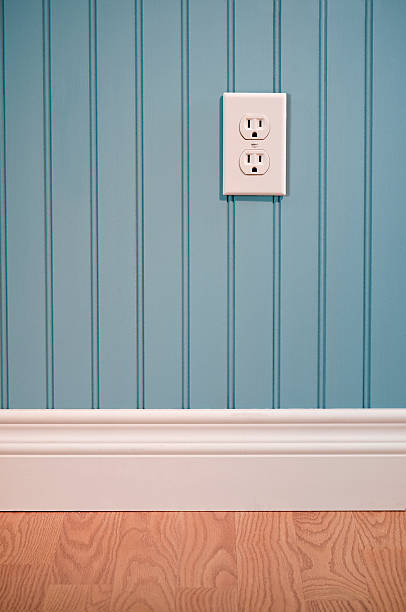 power outlet in empty room - electrical outlet stock photos and pictures