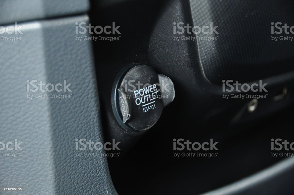 12V power outlet socket in a car stock photo
