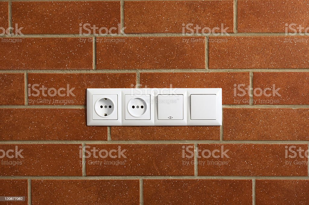 power outlets on the brick wall / horizontal / photo royalty-free stock photo