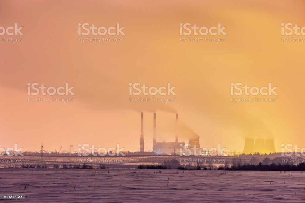 Power plant and cooling towers at dusk stock photo