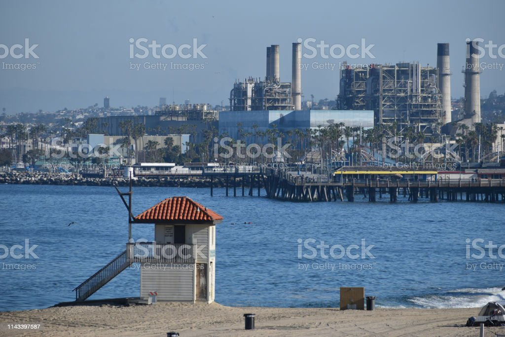 Power Plant and Pier with Lifeguard Station stock photo