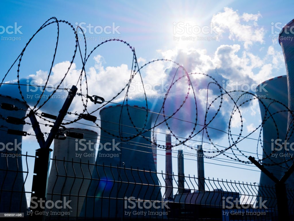 Power Plant bihand Fence with Barbed Wire. stock photo