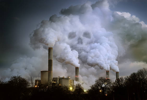 Power Plant Billowing Smoke in Shape of Skull stock photo