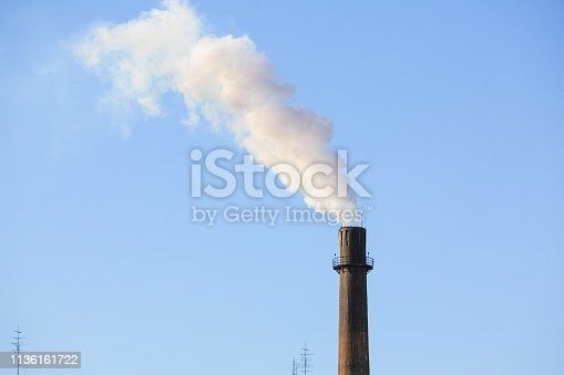 istock Power plant chimney 1136161722